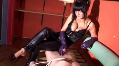 Bondage tied sub gets a latex gloved handjob milking