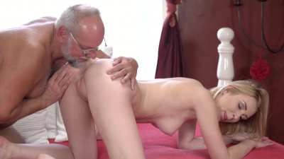 Young chick plays a game of cards on stripping with her grandad