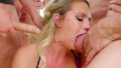Big-busted Cali Carter loves getting her mouth used by seven studs