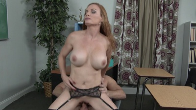 Professor Diamond Foxxx has her student pounding her pussy in the class
